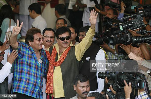 Newly elected member of Parliament Vinod Khanna and Shatrughan Sinha pose after the BJP Parliamentary party meeting at Parliament House on May 20...