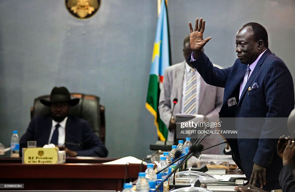 Newly elected Minister of Interior and former rebel member Alfred Ladu Gore (R) greets the President of South Sudan Salva Kiir (L) and the 30 newly elected members of the cabinet of the Transitional Government at the Cabinet Affairs Ministry in Juba on April 29, 2016. South Sudan President Salva Kiir has named his transitional unity government, sharing power with ex-rebels in a key step in a long-delayed peace process, a decree read out on April 29 said. Under terms of an August 2015 peace deal, the 30 ministerial posts are split between Kiir, former rebel chief turned first vice president Riek Machar, opposition and other parties. FARRAN