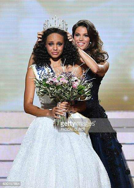 Newly elected Miss France 2017 Alicia Aylies is crowned by Miss France 2016 Iris Mittenaere at the end of the Miss France 2017 beauty contest on...