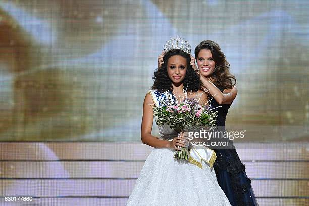 Newly elected Miss France 2017 Alicia Aylies is crowned by Miss France 2016 Iris Mittenaere after winning the Miss France 2017 beauty contest on...
