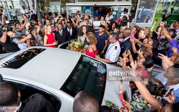 Newly elected Miss France 2017 Alicia Aylies is welcomed by the crowd upon her arrival at the Felix Eboue airport in Cayenne on the French department...