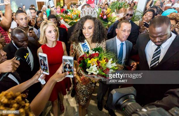 Newly elected Miss France 2017 Alicia Aylies next to Miss France Society President and Miss France 2002 Sylvie Tellier is welcomed by the crowd and...