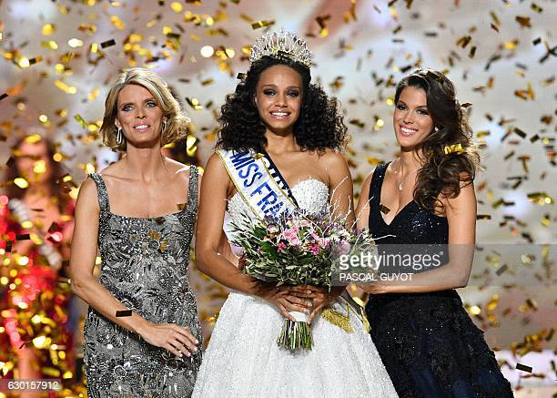 Newly elected Miss France 2017 Alicia Aylies poses with the crown next to Miss France Society President and Miss France 2002 Sylvie Tellier and Miss...