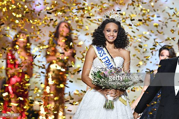 Newly elected Miss France 2017 Alicia Aylies reacts after being crowned during the Miss France 2017 beauty contest on December 17 2016 in Montpellier...