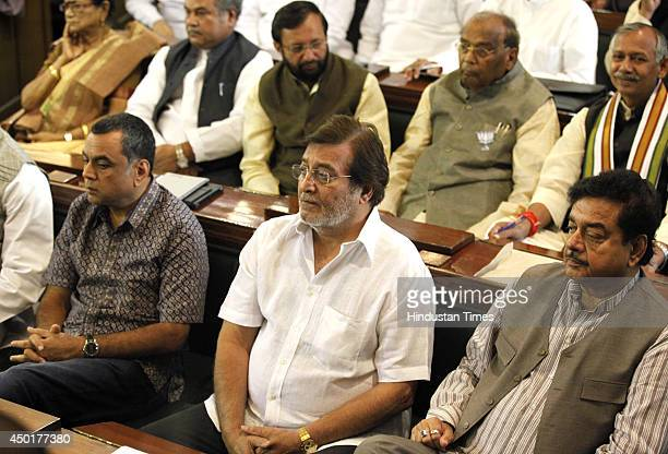 Newly elected MPs Paresh Rawal Vinod Khanna and Shatrughan Sinha of BJP during parliamentary party meeting in the Central Hall of Parliament on June...