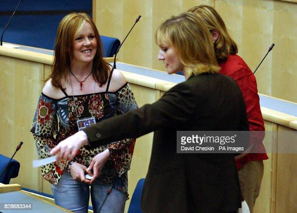 Newly elected MSP s for the Scottish Scoialist Party Rosie Kane and Carolyn Leckie take their seats before the oath of allegiance at the first...