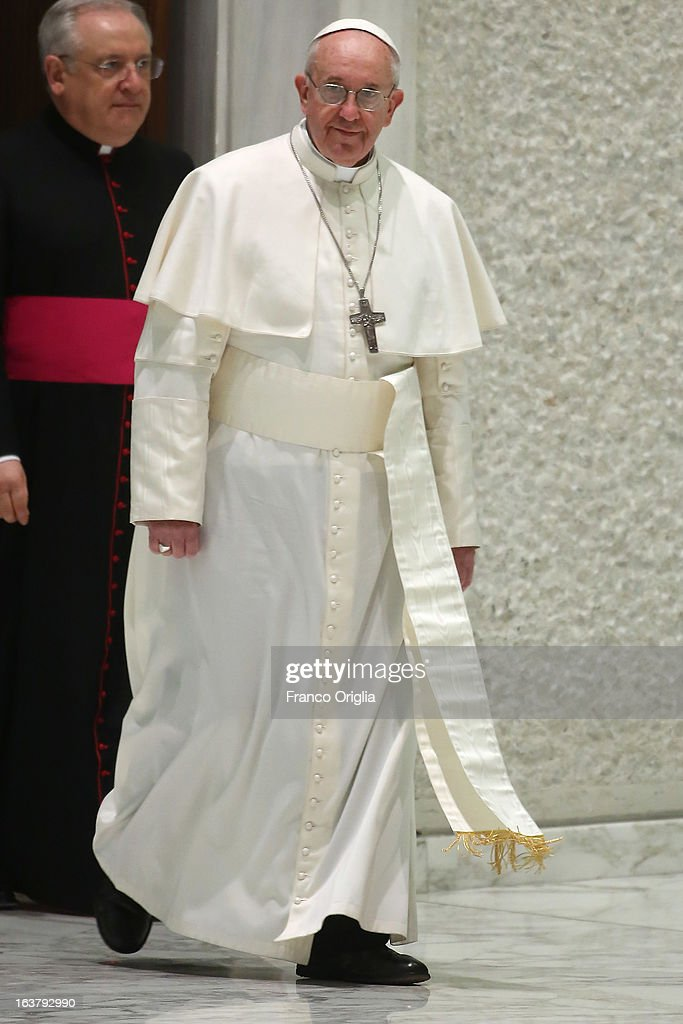 Newly elected <a gi-track='captionPersonalityLinkClicked' href=/galleries/search?phrase=Pope+Francis&family=editorial&specificpeople=2499404 ng-click='$event.stopPropagation()'>Pope Francis</a> arrives for his first audience with journalists and media inside the Paul VI hall on March 16, 2013 in Vatican City, Vatican. The pope thanked the media for their coverage during the historic transition of the papacy and explained his vision of the future for the Catholic Church.