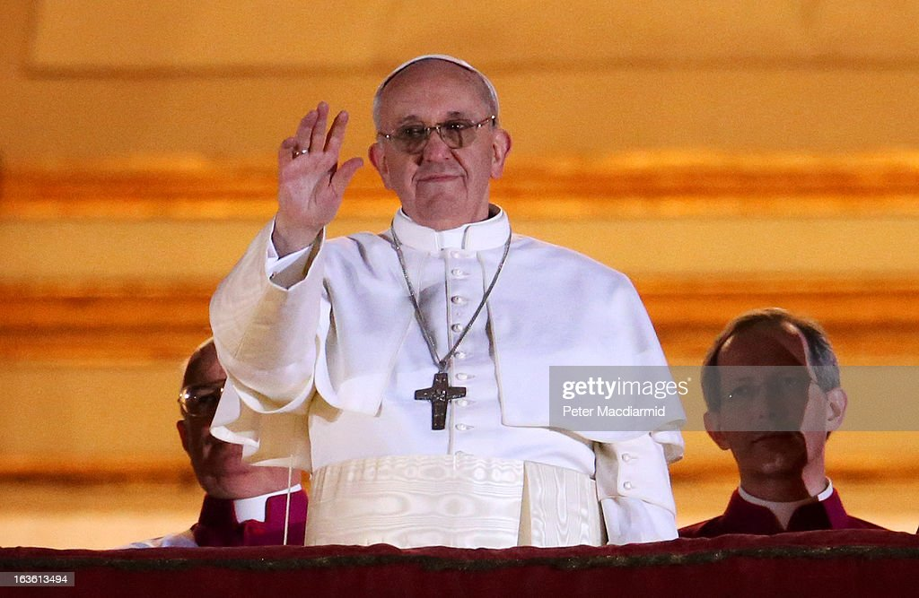 Newly elected Pope Francis I waves to the waiting crowd from the central balcony of St Peter's Basilica on March 13, 2013 in Vatican City, Vatican. Argentinian Cardinal Jorge Mario Bergoglio was elected as the 266th Pontiff and will lead the world's 1.2 billion Catholics.