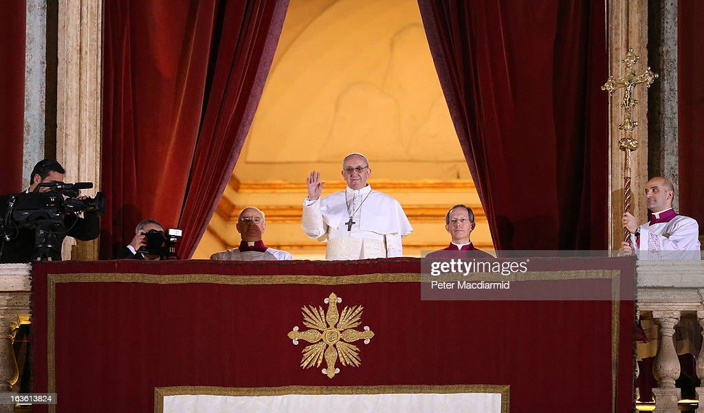 Newly elected <a gi-track='captionPersonalityLinkClicked' href=/galleries/search?phrase=Pope+Francis&family=editorial&specificpeople=2499404 ng-click='$event.stopPropagation()'>Pope Francis</a> I waves to the waiting crowd from the central balcony of St Peter's Basilica on March 13, 2013 in Vatican City, Vatican. Argentinian Cardinal Jorge Mario Bergoglio was elected as the 266th Pontiff and will lead the world's 1.2 billion Catholics.
