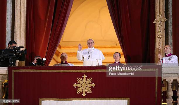 Newly elected Pope Francis I waves to the waiting crowd from the central balcony of St Peter's Basilica on March 13 2013 in Vatican City Vatican...