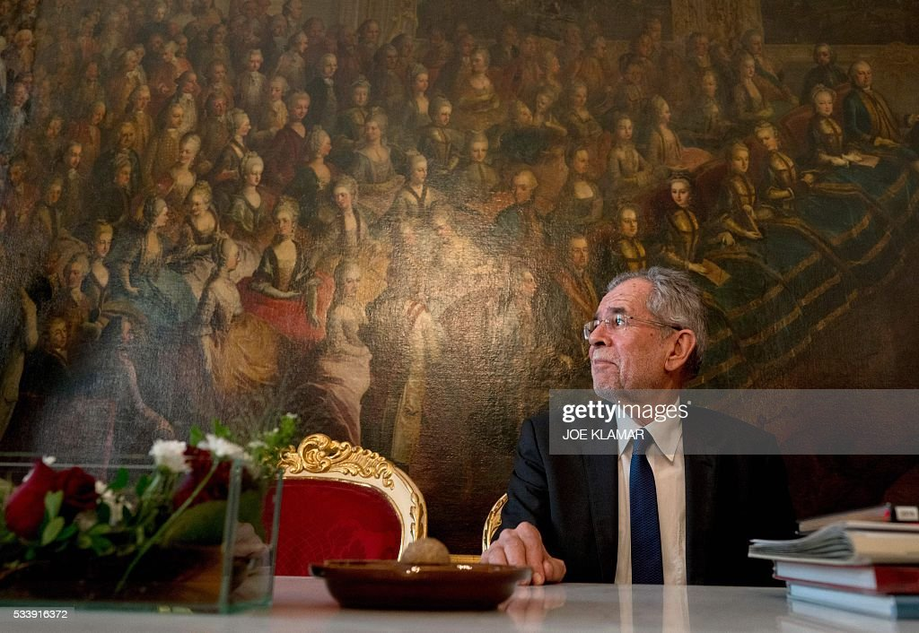 Newly elected President Alexander Van der Bellen of Austrian Greens sits in Austrian President office during their meeting at the presidential palace in Hofburg palace in Vienna on May 24, 2016. / AFP / JOE