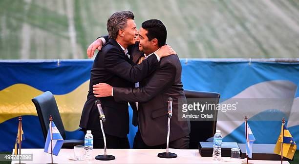Newly elected President of Argentina Mauricio Macri and Daniel Angelici President of Boca Juniors greet each other during a ceremony to honor newly...