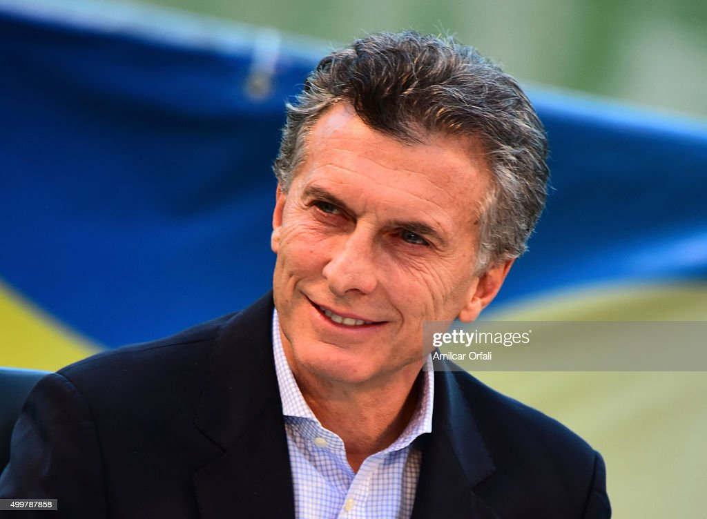 Newly elected president of Argentina Mauricio Macri smiles during a ceremony to honor newly elected President of Argentina Mauricio Macri for his work as President of Boca Juniors between 1995 and 2007 and wish him success as President of Argentina at Alberto J Armando Stadium on December 02, 2015 in Buenos Aires, Argentina.