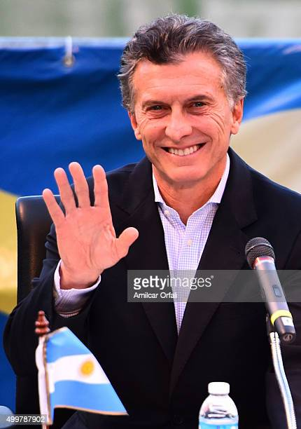 Newly elected President of Argentina Mauricio Macri smiles during a ceremony to honor newly elected President of Argentina Mauricio Macri for his...