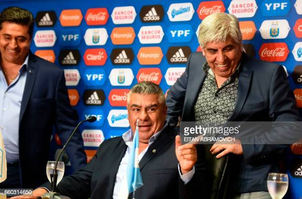 Newly elected President of Argentina's Football Association Claudio Tapia arrives for a press conference next to Boca Juniors' president Daniel...