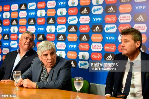 Newly elected President of Argentina's Football Association Claudio Tapia attends a press conference next to Independiente's president Hugo Moyano...