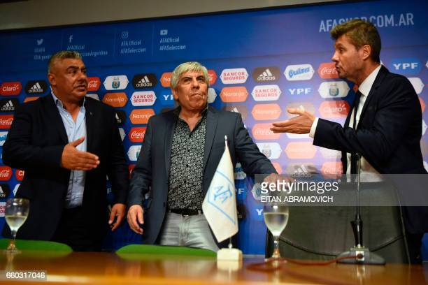 Newly elected President of Argentina's Football Association Claudio Tapia Independiente's president Hugo Moyano and the president of the National...