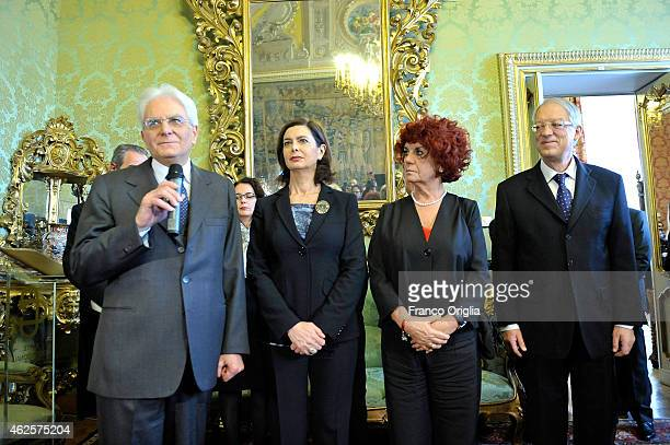 Newly elected President of Italy Sicilian judge Sergio Mattarella stands next to the president of the Parliament Laura Boldrini and the vicepresident...
