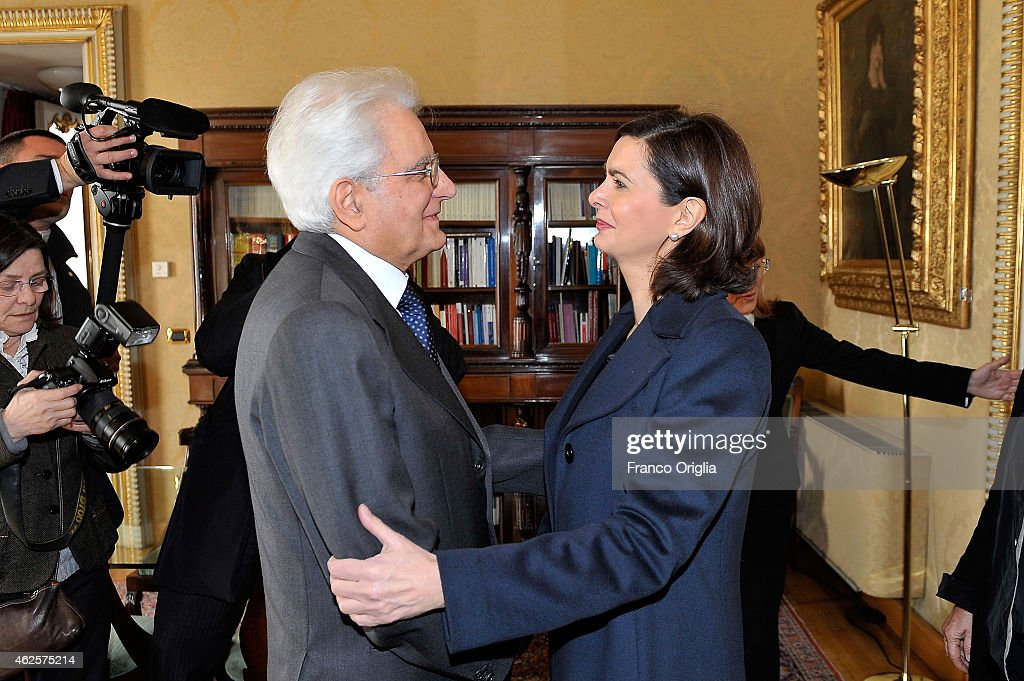 Newly elected President of Italy, Sicilian judge <a gi-track='captionPersonalityLinkClicked' href=/galleries/search?phrase=Sergio+Mattarella&family=editorial&specificpeople=2894690 ng-click='$event.stopPropagation()'>Sergio Mattarella</a> (L) stands next to the president of the Parliament <a gi-track='captionPersonalityLinkClicked' href=/galleries/search?phrase=Laura+Boldrini&family=editorial&specificpeople=4364882 ng-click='$event.stopPropagation()'>Laura Boldrini</a> at the Constitutional Court of Italy in Rome, on January 31, 2015.o on January 31, 2015 in Rome, Italy. Sicilian judge <a gi-track='captionPersonalityLinkClicked' href=/galleries/search?phrase=Sergio+Mattarella&family=editorial&specificpeople=2894690 ng-click='$event.stopPropagation()'>Sergio Mattarella</a> becomes Italy's 12th president and replaces 89-year-old Giorgio Napolitano, who resigned on January 14 due to age.