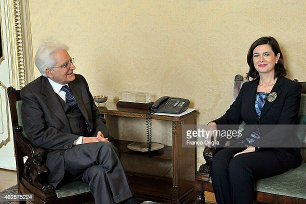 Newly elected President of Italy Sicilian judge Sergio Mattarella stands next to the president of the Parliament Laura Boldrini at the Constitutional...