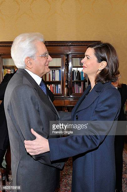Newly elected President of Italy Sicilian judge Sergio Mattarella stands with the president of the Parliament Laura Boldrini at the Constitutional...