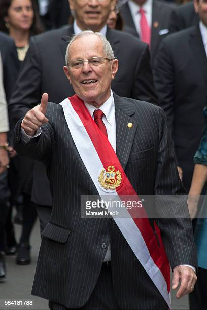 Newly elected President of Peru Pedro Pablo Kuczynski gestures as he walks along with his cabinet towards Palacio de Gobierno after the swearing in...