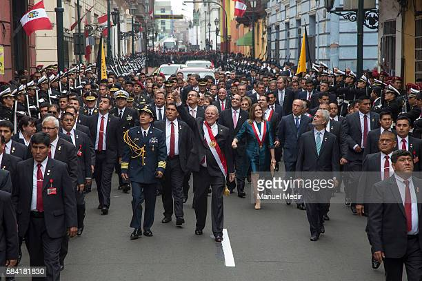 Newly elected President of Peru Pedro Pablo Kuczynski walks along with his cabinet towards Palacio de Gobierno after the swearing in ceremony at...
