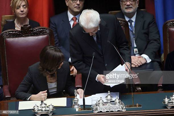 Newly elected President of Republic Sergio Mattarella flanked by President of the Chamber of Deputies Laura Boldrini looses the sheets of his...