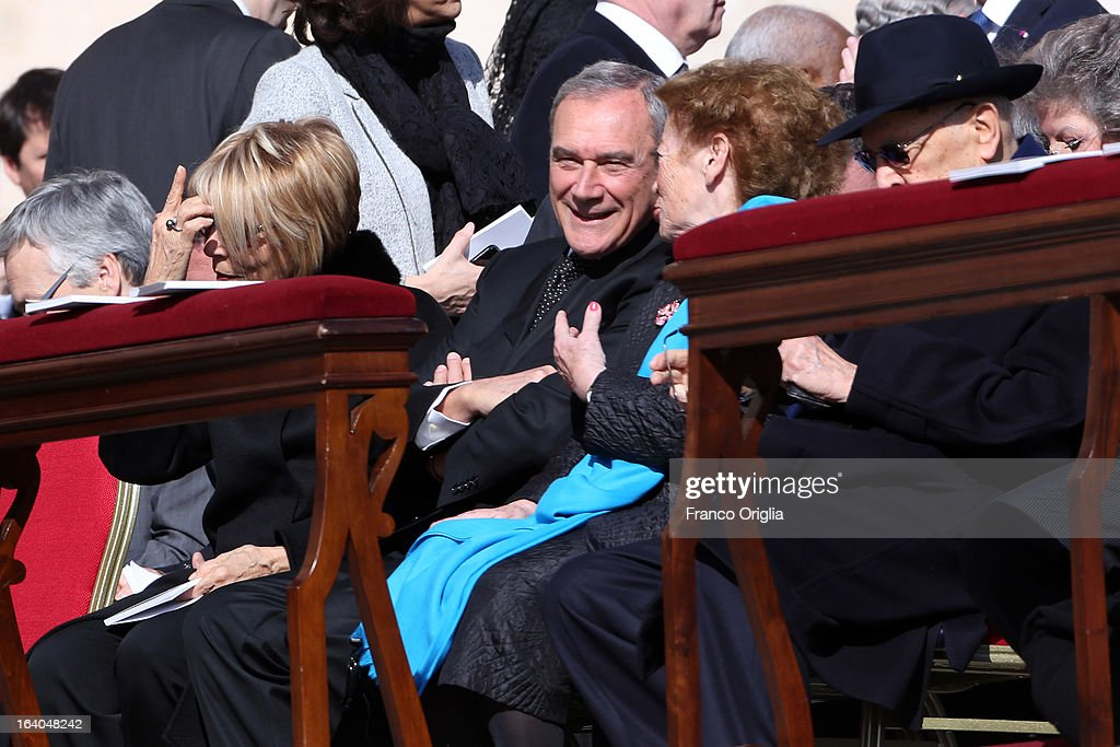 Newly elected President of the Italian Senate <a gi-track='captionPersonalityLinkClicked' href=/galleries/search?phrase=Piero+Grasso&family=editorial&specificpeople=681169 ng-click='$event.stopPropagation()'>Piero Grasso</a> (C) smiles as he attends with Italy's First Lady Clio Napolitano (2R) and Italy's President <a gi-track='captionPersonalityLinkClicked' href=/galleries/search?phrase=Giorgio+Napolitano&family=editorial&specificpeople=568986 ng-click='$event.stopPropagation()'>Giorgio Napolitano</a> (R) the Inauguration Mass of Pope Francis on March 19, 2013 in Vatican City, Vatican. The inauguration of Pope Francis is being held in front of an expected crowd of up to one million pilgrims and faithful who have crowded into St Peter's Square and the surrounding streets to see the former Cardinal of Buenos Aires officially take up his position. Pope Francis' inauguration takes place in front his cardinals, spiritual leaders as well as heads of states from around the world and he will now lead an estimated 1.3 billion Catholics.