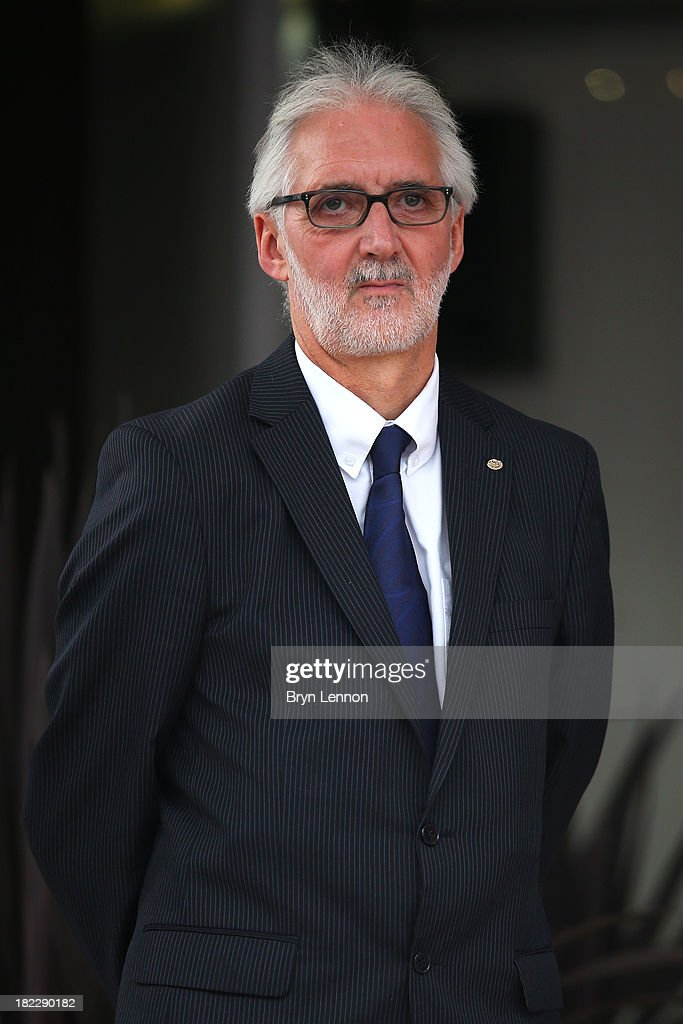 Newly elected President of the UCI Brian Cookson OBE awaits the podium ceremony after the Elite Men's Road Race, a 272km race from Lucca to Florence on September 29, 2013 in Florence, Italy.