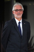 Newly elected President of the UCI Brian Cookson OBE awaits the podium ceremony after the Elite Men's Road Race a 272km race from Lucca to Florence...