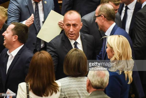 Newly elected Prime Minister of Kosovo Ramush Haradinaj is greeted by the members of the Kosovo parliament during a parliament session in Pristina on...