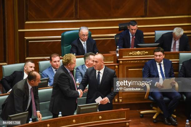 Newly elected Prime Minister of Kosovo Ramush Haradinaj is greeted by the new members of the Kosovo government during a parliament session in...
