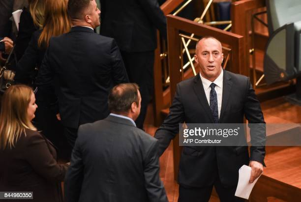 Newly elected Prime Minister of Kosovo Ramush Haradinaj looks on during a parliament session in Pristina on September 9 2017 / AFP PHOTO / Armend...