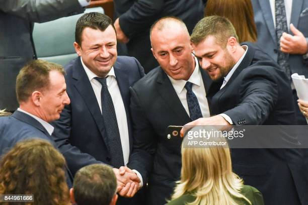 Newly elected Prime Minister of Kosovo Ramush Haradinaj poses for a selfie with the members of the Kosovo parliament during a parliament session in...
