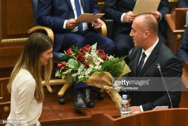 Newly elected Prime Minister of Kosovo Ramush Haradinaj receives a bouquet of flowers during a parliament session in Pristina on September 9 2017 /...