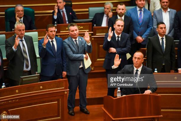 Newly elected Prime Minister of Kosovo Ramush Haradinaj takes an oath with the new members of the Kosovo government during a parliament session in...