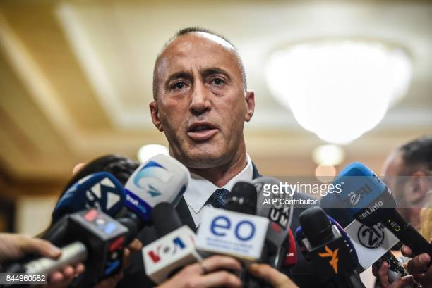 Newly elected Prime Minister of Kosovo Ramush Haradinaj talks to the press after a parliament session in Pristina on September 9 2017 / AFP PHOTO /...