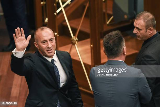 Newly elected Prime Minister of Kosovo Ramush Haradinaj waves after a parliament session in Pristina on September 9 2017 / AFP PHOTO / Armend NIMANI