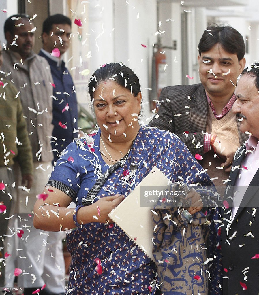 Newly elected Rajasthan Chief Minister Vasundhara Raje receives grand welcome by party workers as she arrives for the BJP's Chief Ministers'...