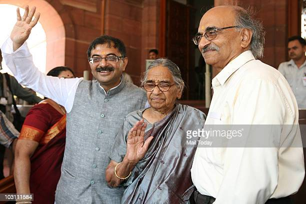 Newly elected Rajya Sabha MP Tarun Vijay along with his family at the parliament house at the first day of the monsoon session in New Delhi on July...