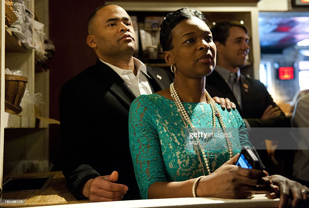Newly elected Rep. Marc Veasey, left, and his wife Tonya, listen to speeches at the Lone Star Project Inauguration Celebration, held Sunday, January 20, 2013 at the Hill Country Barbecue in Washington, D.C.