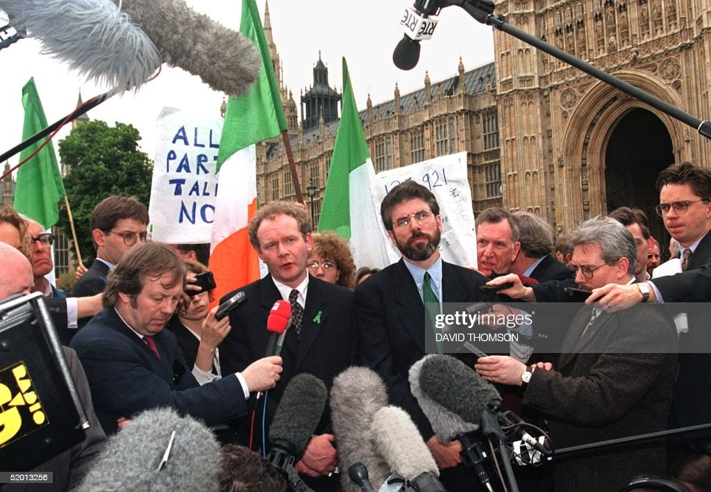 Newly elected Sinn Fein MPs Gerry Adams (R) and Martin McGuinness talk to newsmen after leaving Parliament at Westminster 19 May after challenging an order barring them from the premises for refusing to swear allegiance to the Queen.