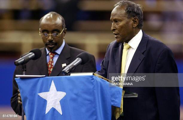 Newly elected Somali president Abdullahi Yusuf Ahmed is sworn in by Somali parliament speaker Sharif Hassan Sheikh Aden in Nairobi 14 October 2004...