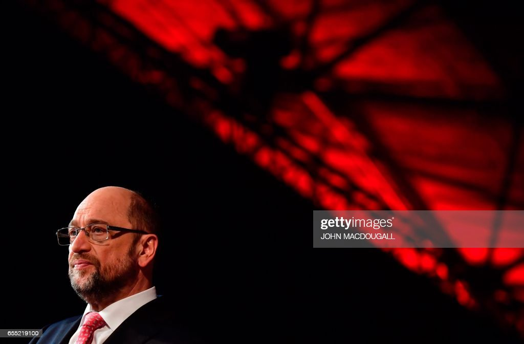 Newly elected SPD leader and candidate for Chancellor of Germany's social democratic SPD party Martin Schulz gives a TV interview after his election during an extraordinary Congress of Germany's Social Democratic Party (SPD) on March 19, 2017 in Berlin. / AFP PHOTO / John MACDOUGALL