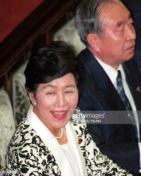 Newly elected speaker of the lower house Takako Doi smiles while attending the extraordinary session 06 August 1993 Doi became the first female...