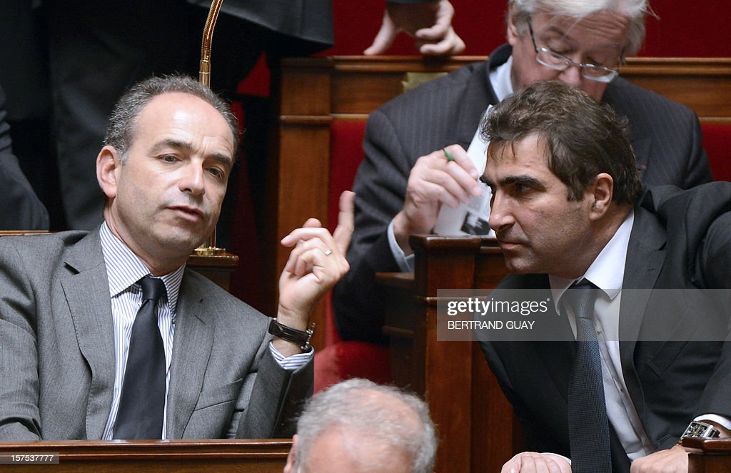 Newly elected UMP president Jean-Francois Cope (L) speaks with the Christian Jacob, head of UMP group at the national assembly, on December 4, 2012 at the National Assembly in Paris, during a session of questions to the government. Former Prime minister Francois Fillon has set up on November 27, 2012 his own faction of the UMP party in the French parliament, demanding a repeat of the leadership ballot within three months. The ex-prime minister said the faction, Rally for the UMP (R-UMP), would be dissolved if a new vote was announced.