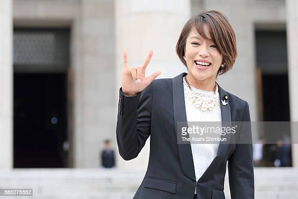 Newly elected upper house lawmaker Eriko Imai poses for photographs as the 191st Diet session begins at the diet building on August 1 2016 in Tokyo...
