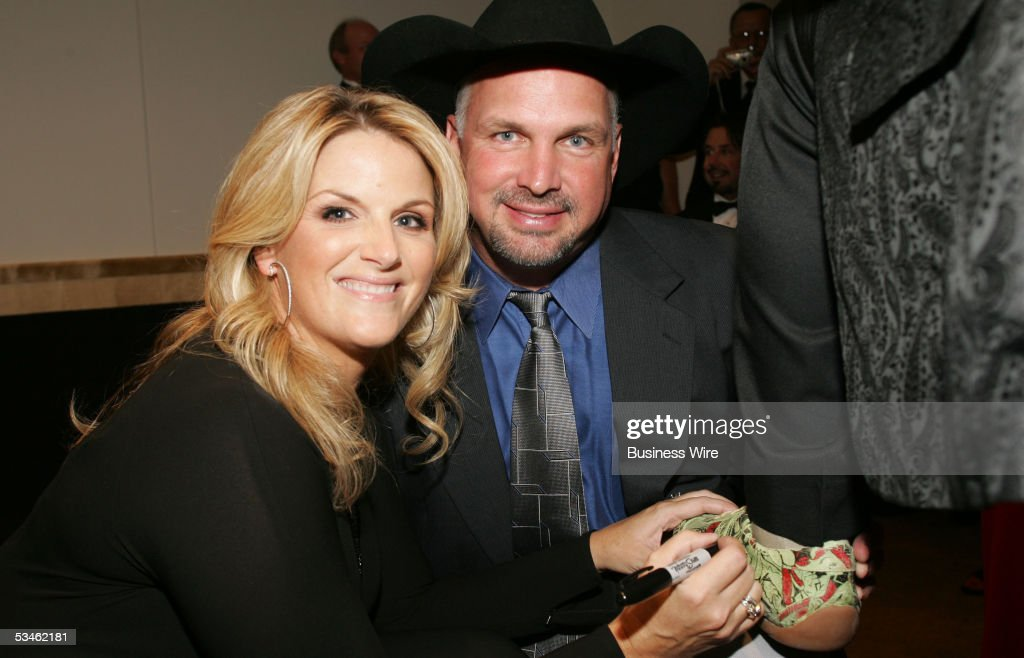 Newly engaged country music stars Trisha Yearwood and <a gi-track='captionPersonalityLinkClicked' href=/galleries/search?phrase=Garth+Brooks&family=editorial&specificpeople=206288 ng-click='$event.stopPropagation()'>Garth Brooks</a> attended the Starkey Hearing Foundation's So the World May Hear Awards Gala in St. Paul, Minnesota, over the weekend. Trisha was the featured performer at the event, and Garth received an award for his charity work. The event raised a record $4 million-plus to provide hearing aids to those in need worldwide. Garth helped out by bidding $250,000 to fund a Starkey hearing mission trip to South Africa.