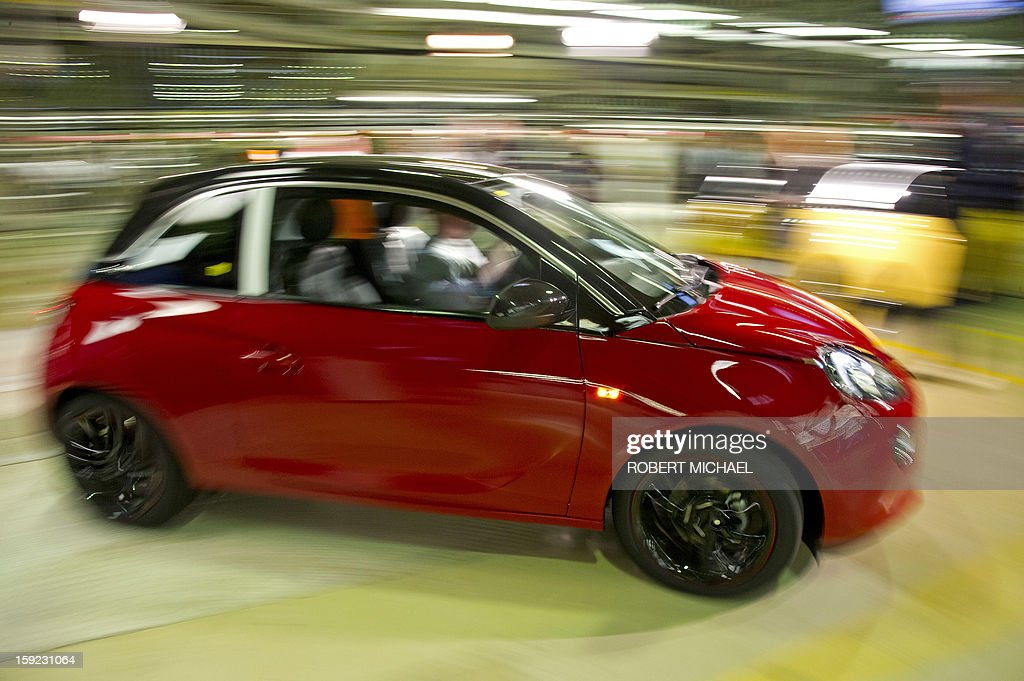 A newly fabricated Opel Adam car leaves the production line at the Opel plant in Eisenach, eastern Germany on January 10, 2013. The new Opel model will be produced as of January 10, 2013 at the Eisenach Opel plant and is intended to attract young automobile drivers in cities. Opel has already received 16 000 orders for the Adam.